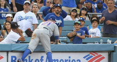 Mets third baseman Todd Frazier chases a foul ball into the stands at Dodger Stadium on Sept. 3, 2018.