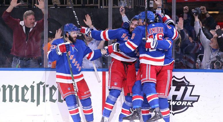 New York Rangers center Mika Zibanejad (93) celebrates his game winning goal against the Washington Capitals during overtime at Madison Square Garden.