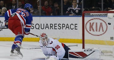 Rangers center Mika Zibanejad scores the game-winning goal against Washington Capitals goalie Ilya Samsonov during overtime on March 5, 2020, at Madison Square Garden.
