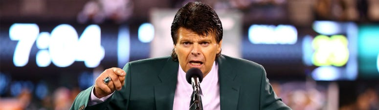 Former Jets All-Pro defensive lineman Mark Gastineau addresses the crown during a haltime ceremony induction him and former Jets wide receiver Wesley Walker into the Jets' RIng of Honor against the Houston Texans at MetLife Stadium on October 8, 2012.