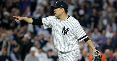 Masahiro Tanaka of the Yankees reacts after the end of the top of the seventh inning against the Houston Astros in Game Five of the American League Championship Series at Yankee Stadium on October 18, 2017.