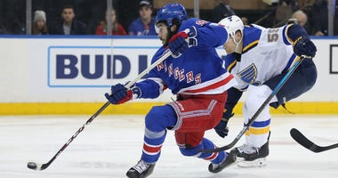 New York Rangers center Mika Zibanejad (93) shoots in front of St. Louis Blues defenseman Colton Parayko (55) during the second period at Madison Square Garden