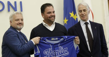Hall of Fame catcher Mike Piazza shows his jersey during his presentation as Italy's national baseball team coach, at the Italian Olympic Committee headquarters in Rome, Friday, Nov. 29, 2019.