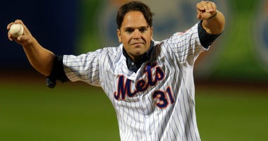 Former Mets catcher Mike Piazza waves before throwing out the first pitch prior to Game Three of the 2015 World Series between the New York Mets and the Kansas City Royals at Citi Field on October 30, 2015 in New York City.