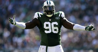 Muhammad Wilkerson of the Jets reacts during their game against the Detroit Lions at MetLife Stadium on September 28, 2014 in East Rutherford, New Jersey.