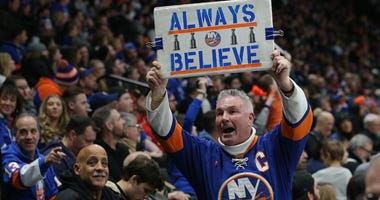 A fan of the New York Islanders displays a sign against the Tampa Bay Lightning on Feb. 1, 2019, at Nassau Veterans Memorial Coliseum in Uniondale, New York.