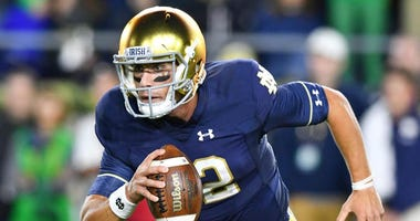 Notre Dame Fighting Irish quarterback Ian Book (12) runs the ball in the first quarter against the Stanford Cardinal at Notre Dame Stadium on Sept. 29, 2018.