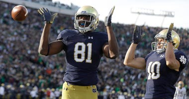 Notre Dame's Miles Boykin (81) celebrates after making the game-winning catch with Chris Finke (10) during the second half of an NCAA college football game against Pittsburgh, Saturday, Oct. 13, 2018, in South Bend, Ind. Notre Dame won 19-14.