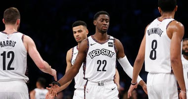 Brooklyn Nets guard Caris LeVert (22) reacts with forward Joe Harris (12) and guard Spencer Dinwiddie (8) in the fourth quarter against the Toronto Raptors at Barclays Center. Mandatory Credit: