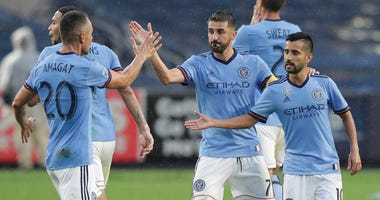 New York City forward David Villa (7) celebrates his goal with teammates during the second half against D.C. United on Sept. 8, 2018, at Yankee Stadium.