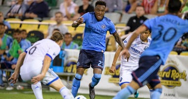 New York City FC forward Rodney Wallace dribbles the ball during the matchup with Montreal Impact at Al Lang Stadium.