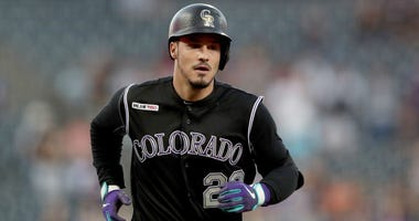 Nolan Arenado #28 of the Colorado Rockies circles the bases after hitting a 2 RBI home run in the first inning against the San Diego Padres at Coors Field on September 13, 2019 in Denver, Colorado