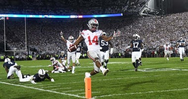 Ohio State Buckeyes wide receiver K.J. Hill (14) crosses the goal line to score the go ahead touchdown in the fourth quarter against the Penn State Nittany Lions at Beaver Stadium on Sept. 29, 2018.
