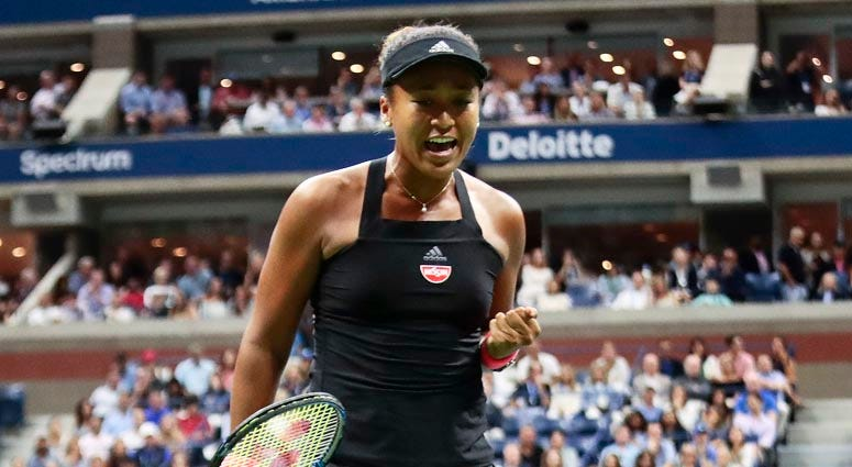 Naomi Osaka reacts after winning a point against Serena Williams during the women's final of the U.S. Open on Sept. 8, 2018,