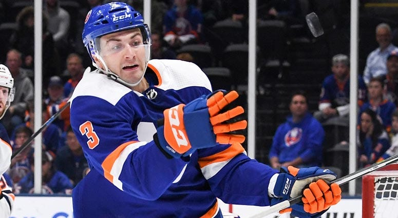 Islanders defenseman Adam Pelech attempts to catch the puck put of the air against the Edmonton Oilers during the first period at Nassau Veterans Memorial Coliseum on Oct. 8, 2019.