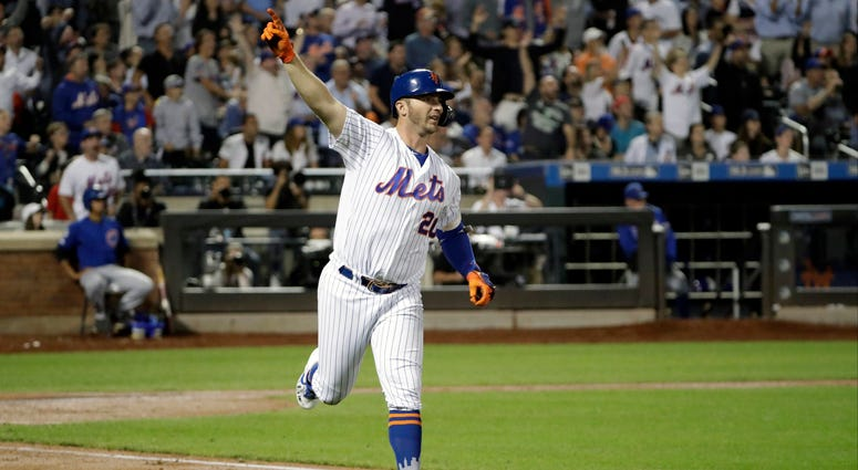 New York Mets' Pete Alonso trots the bases after hitting a solo home run during the fourth inning of a baseball game, Tuesday, Aug. 27, 2019, in New York. With the home run, Alonso broke the Mets' single season home run record.