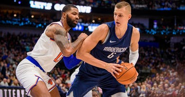 Knicks forward Marcus Morris (13) and Mavericks forward Kristaps Porzingis (6) in action during the game between the Mavericks and the Knicks at the American Airlines Center.