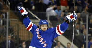 Artemi Panarin (10) celebrates getting an assist on a goal scored by Rangers left wing Chris Kreider (not pictured) during the second period against the New York Islanders at Madison Square Garden