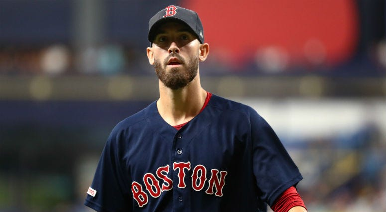 Boston Red Sox starting pitcher Rick Porcello (22) looks on at the end of the third inning against the Tampa Bay Rays at Tropicana Field