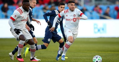 Alejandro Pozuelo of Toronto FC dribbles the ball during the first half of an MLS game against New York City FC at BMO Field on March 07, 2020 in Toronto, Canada.