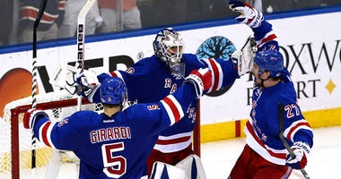 The Rangers' Henrik Lundqvist celebrates with teammates Dan Girardi and Ryan McDonagh after defeating the Montreal Canadiens in Game 6 to win the Eastern Conference finals on May 29, 2014, at Madison Square Garden.