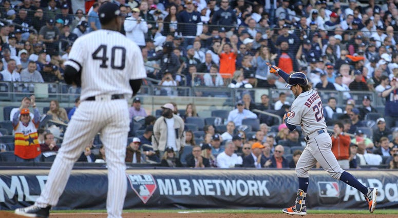 Astros right fielder Josh Reddick rounds the bases after hitting a solo home run as  Yankees pitcher Luis Severino looks on during Game 3 of the ALCS on Oct. 15, 2019, at Yankee Stadium.