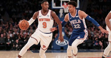 Knicks forward RJ Barrett dribbles as Philadelphia 76ers guard Matisse Thybulle defends on Nov. 29, 2019, at Madison Square Garden.