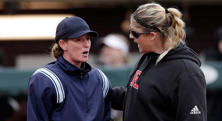 Rutgers head coach Kristen Butler, right, argues a call with the home plate umpire during a game in February.