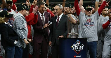 MLB commissioner Rob Manfred presents the Washington Nationals with the Commissioners Trophy after defeating the Houston Astros in game seven of the 2019 World Series at Minute Maid Park.