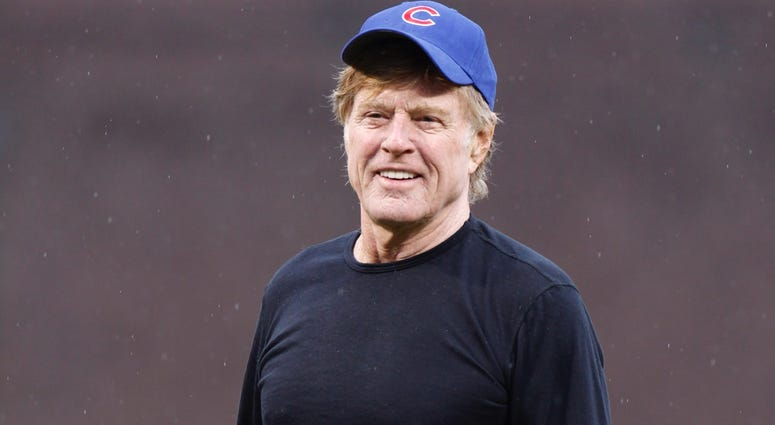 Actor Robert Redford smiles after throwing out the first pitch prior to the Chicago Cubs playing the Pittsburgh Pirates on opening day at Wrigley Field on April 1, 2011 in Chicago, Illinois