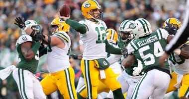 Dec 23, 2018; Green Bay Packers quarterback Aaron Rodgers (12) throws a pass as New York Jets inside linebacker Avery Williamson (54) defends during the second half against the New York Jets. Credit: Vincent Carchietta-USA TODAY Sports