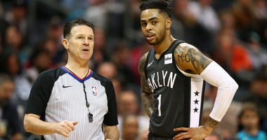 Feb 23, 2019; Charlotte, NC, USA; Brooklyn Nets guard D'Angelo Russell (1) talks with referee Pat Fraher (26) during the second half against the Charlotte Hornets at Spectrum Center. Mandatory Credit: Jeremy Brevard-USA TODAY Sports