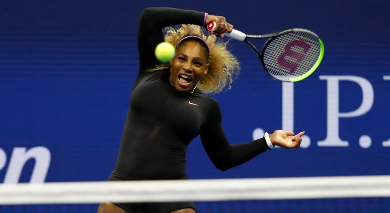 Serena Williams hits a forehand against Maria Sharapova on Aug. 26, 2019, at the U.S. Open.