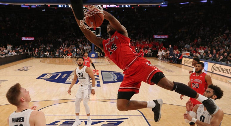 St. John's guard Mustapha Heron dunks against Marquette during a quarterfinal game of the Big East conference tournament on March 14, 2019, at Madison Square Garden.