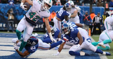 Patrick Laird of the Miami Dolphins is tackled for a safety by Sam Beal of the New York Giants in the third quarter during their game at MetLife Stadium on December 15, 2019 in East Rutherford, New Jersey.