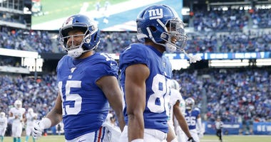 Golden Tate III #15 of the New York Giants celebrates his touchdown with teammate Darius Slayton #86 in the second quarter against the Miami Dolphins at MetLife Stadium