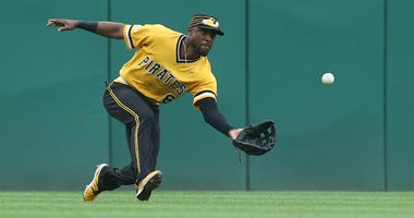 Pittsburgh Pirates center fielder Starling Marte makes a catch against the St. Louis Cardinals during the ninth inning at PNC Park on Sep 8, 2019.