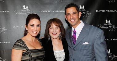 Suzyn Waldman poses with Jorge & Laura Posada