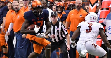 Nov 9, 2018; Syracuse, NY, USA; Syracuse Orange wide receiver Jamal Custis (17) runs with the ball against Louisville Cardinals cornerback Cornelius Sturghill (3) after making a catch during the third quarter. Mark Konezny-USA TODAY Sports