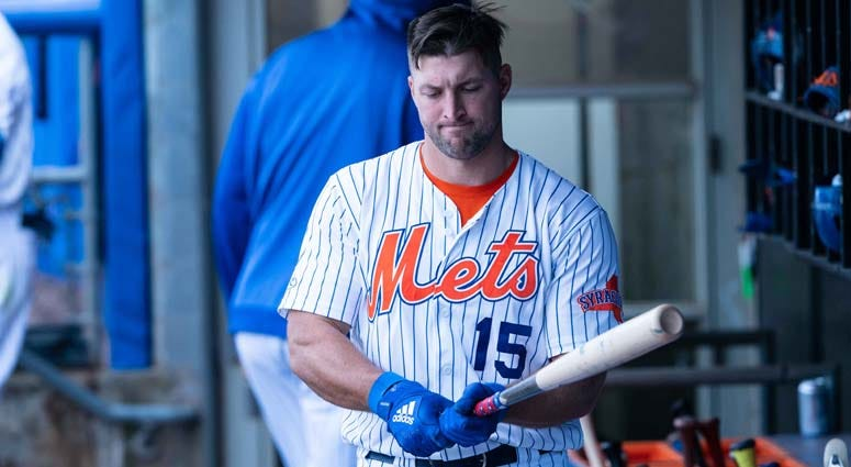 Syracuse Mets left fielder Tim Tebow prepares for an at-bat against the Buffalo Bisons on April 25, 2019, at NBT Bank Stadium in Syracuse.