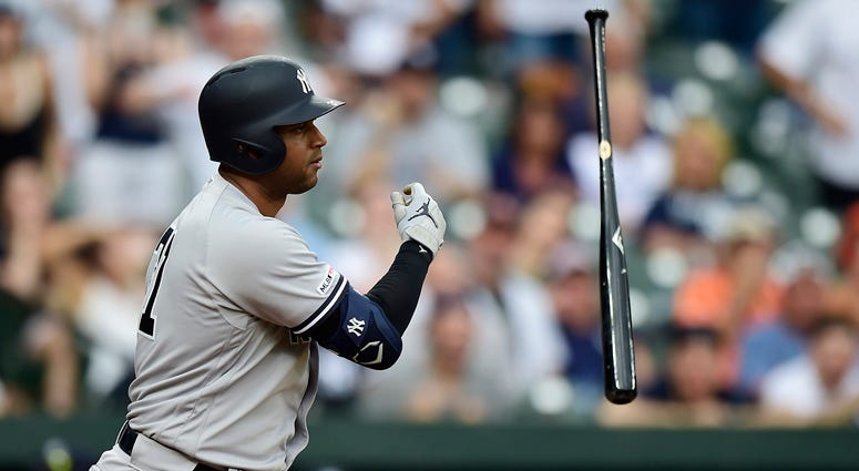 The Yankees' Aaron Hicks tosses his bat after being walked with the bases loaded in the ninth inning against the Orioles on may 23, 2019, at Oriole Park at Camden Yards on May 23, 2019, in Baltimore.