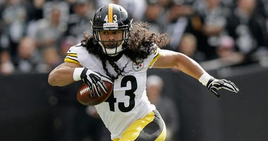 Troy Polamalu #43 of the Pittsburgh Steelers returns an interception against the Pittsburgh Steelers at O.co Coliseum on October 27, 2013 in Oakland, California.