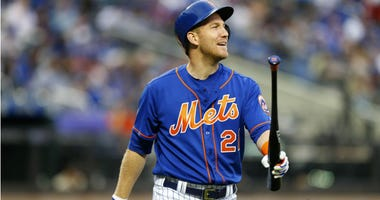 Todd Frazier reacts after striking out against the Los Angeles Dodgers in the first inning at Citi Field.