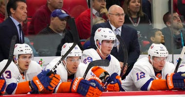 Oct 28, 2018; Raleigh, NC, USA; New York Islanders head coach Barry Trotz (right) looks on from behind the players bench against the Carolina Hurricanes at PNC Arena. Mandatory Credit: James Guillory-USA TODAY Sports
