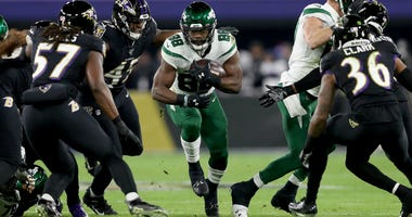 Running back Ty Montgomery of the Jets carries the ball against the defense of the Ravens at M&T Bank Stadium on December 12, 2019 in Baltimore, Maryland.