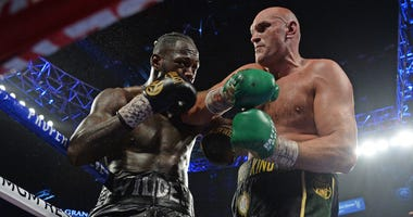 Deontay Wilder and Tyson Fury box during their WBC heavyweight title bout at MGM Grand Garden Arena.