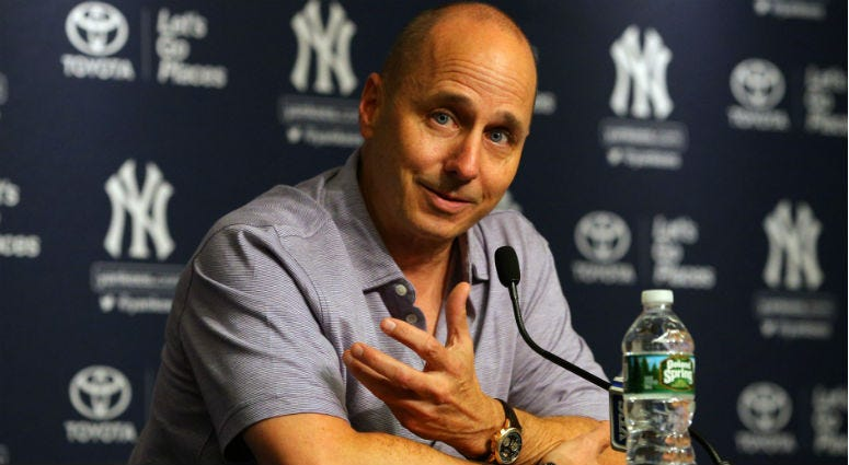 Brian Cashman speaks with the media before a game against the Detroit Tigers at Yankee Stadium. The Yankees today traded for Oakland Athletics pitcher Sonny Gray at the MLB trade deadline.