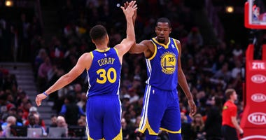 Stephen Curry reacts with Kevin Durant after making a three point basket against the Chicago Bulls during the second half at the United Center in Chicago.
