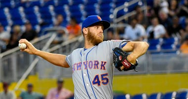 Zack Wheeler throws in the second inning against the Miami Marlins during a MLB game at Marlins Park
