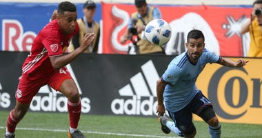 New York Red Bulls midfielder Tyler Adams  and New York City FC midfielder Maximiliano Moralez in action at Red Bull Arena.